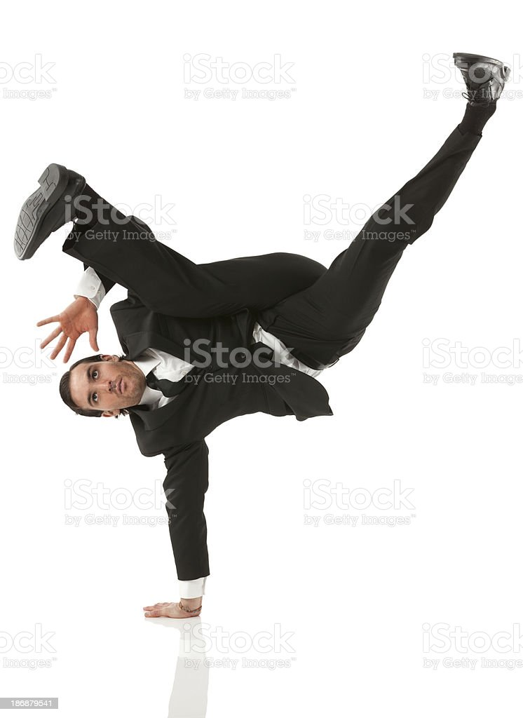 Businessman doing handstand stock photo