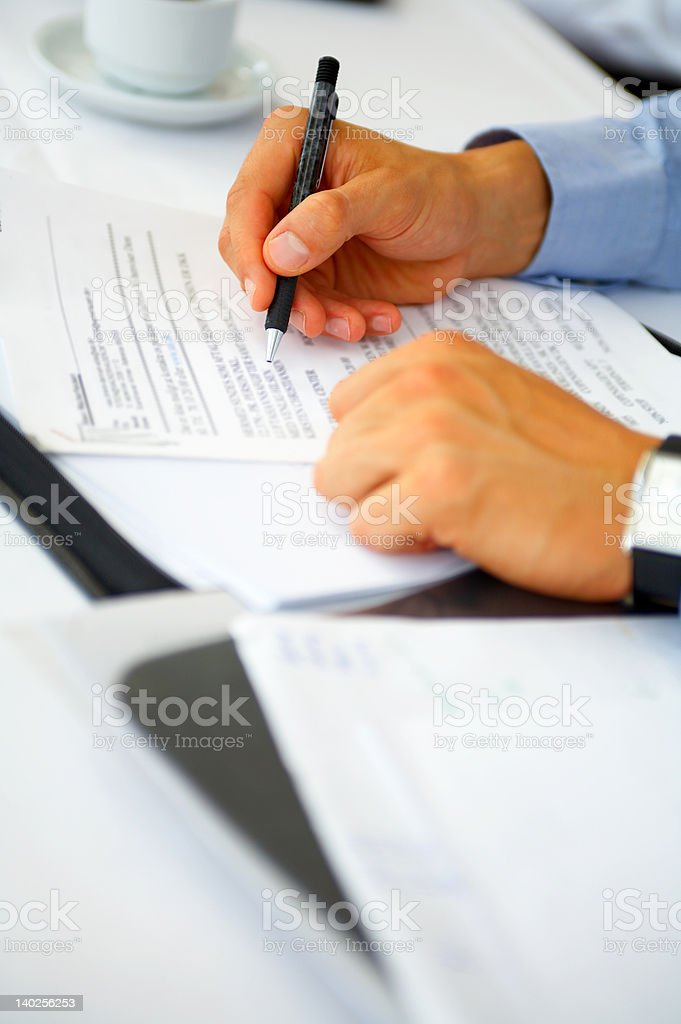 Businessman doing paperwork royalty-free stock photo