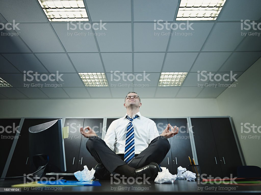 businessman doing yoga in office royalty-free stock photo