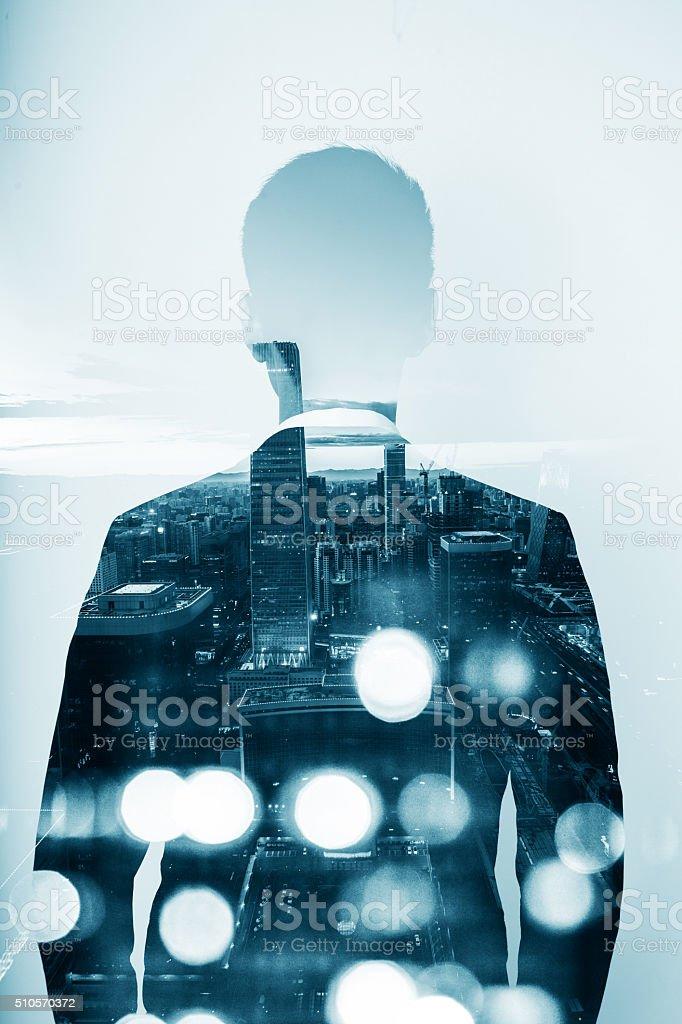 Businessman double exposure stock photo