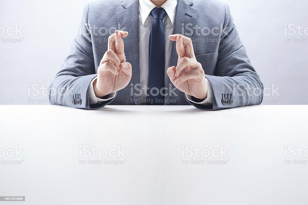 Businessman Double Fingers Crossed stock photo