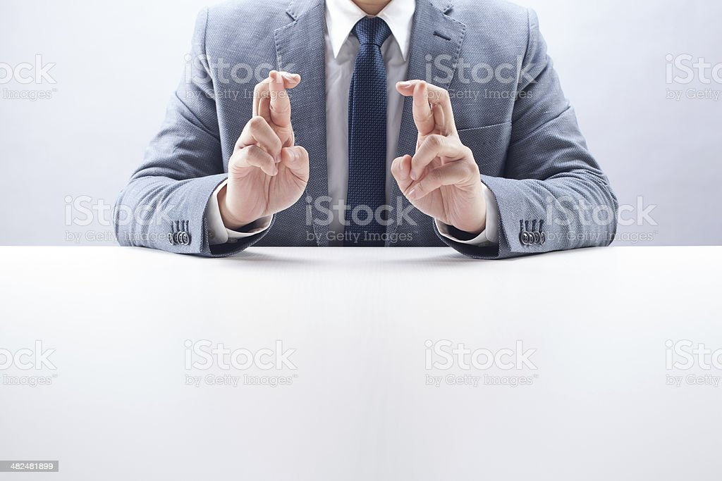 Businessman Double Fingers Crossed stock photo