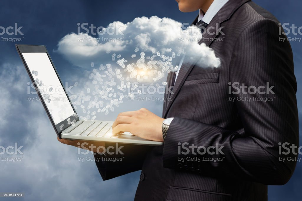 Businessman download letters from the data cloud. stock photo