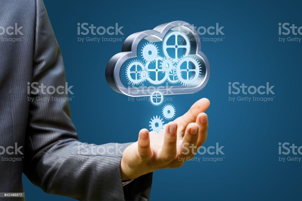 Businessman downloads data from the cloud. stock photo