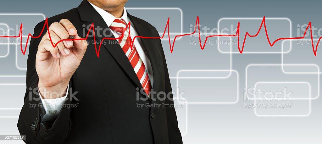Businessman draw a pulse line stock photo