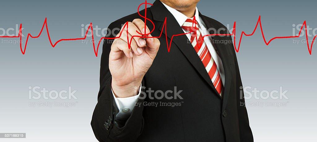 Businessman draw a pulse stock photo