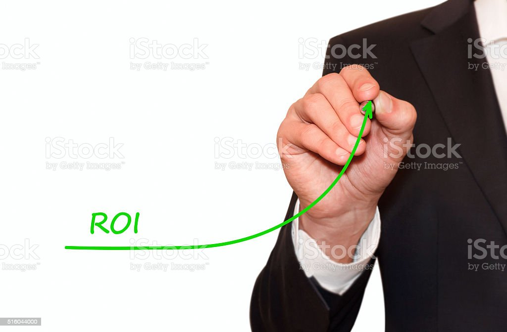 Businessman draw plan to increase ROI stock photo