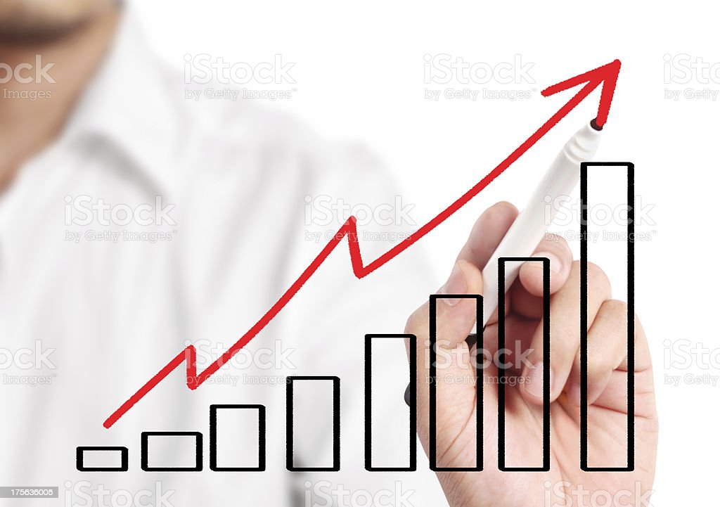 A businessman drawing a arrow and graph royalty-free stock photo