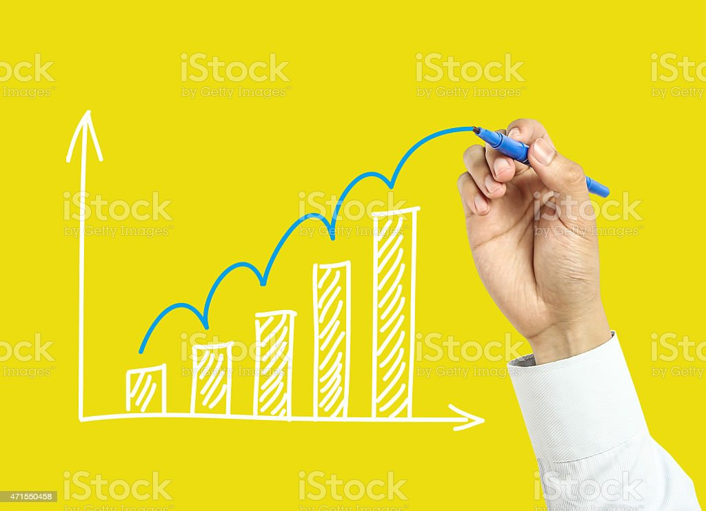 Businessman drawing a growth graph stock photo