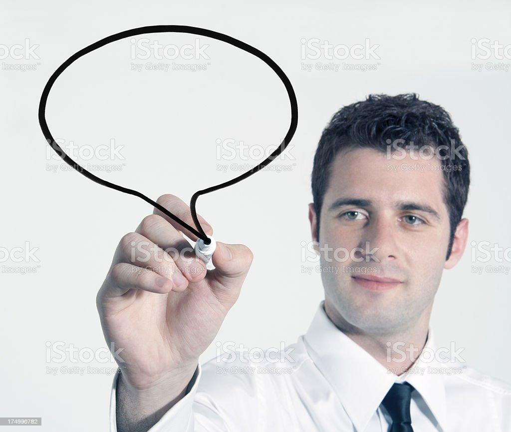 Businessman drawing bubble on screen royalty-free stock photo