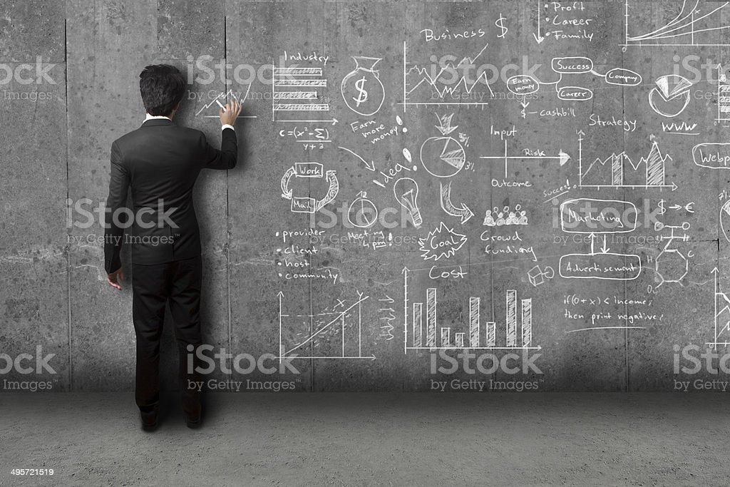businessman drawing concept and strategy sketch on wall stock photo