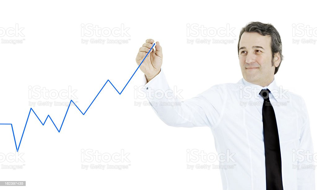 Businessman drawing economic chart royalty-free stock photo