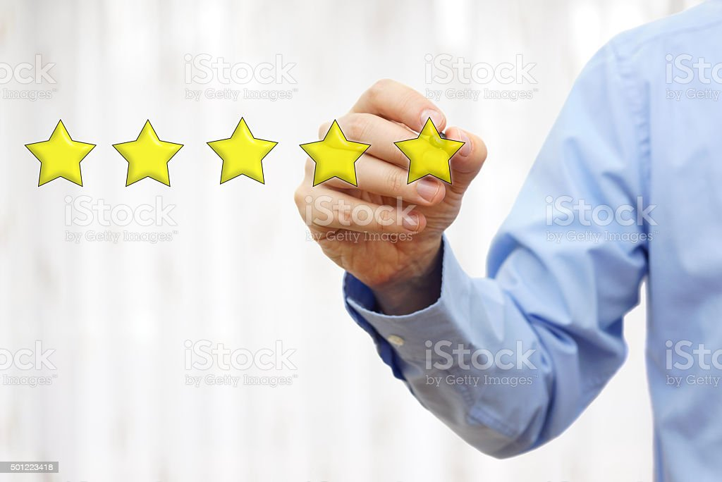 businessman drawing five star rating,concept of quality and luxury stock photo