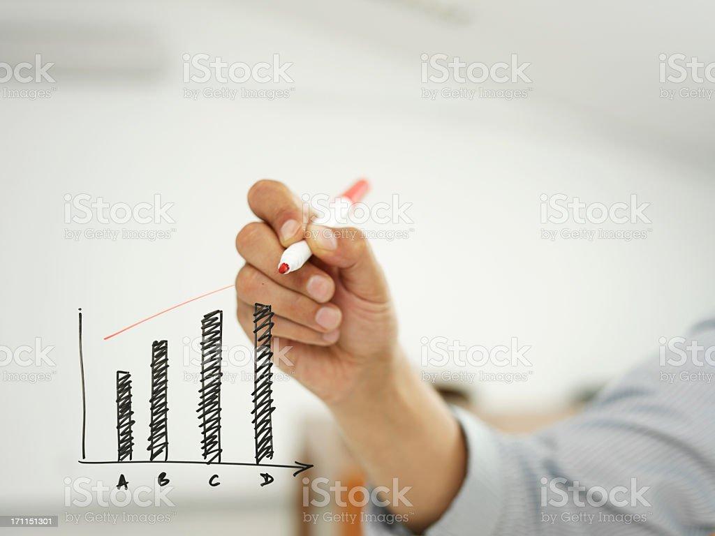 businessman drawing graph stock photo