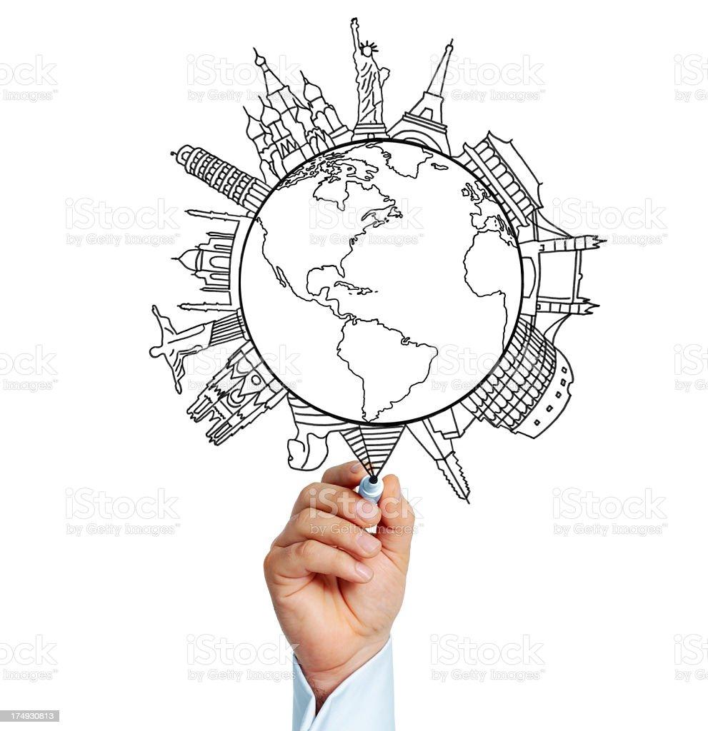 Businessman drawing important city landmarks on globe royalty-free stock photo