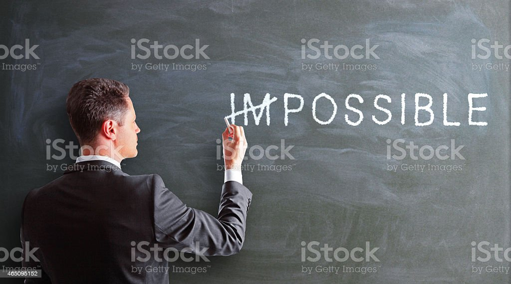 businessman drawing impossible stock photo
