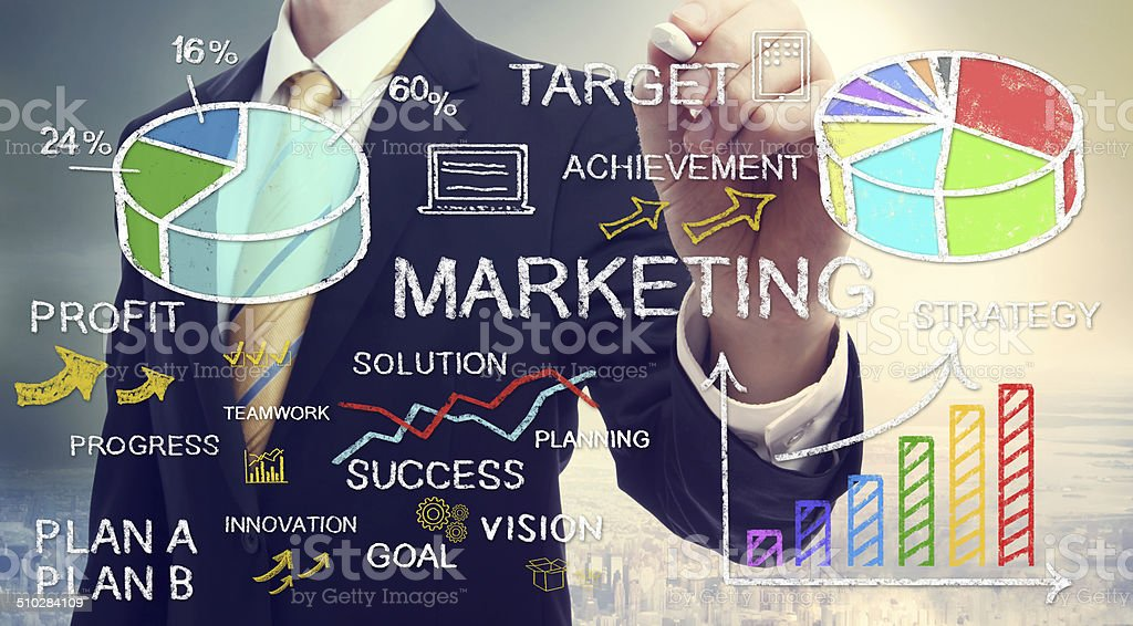 Businessman drawing marketing concepts stock photo