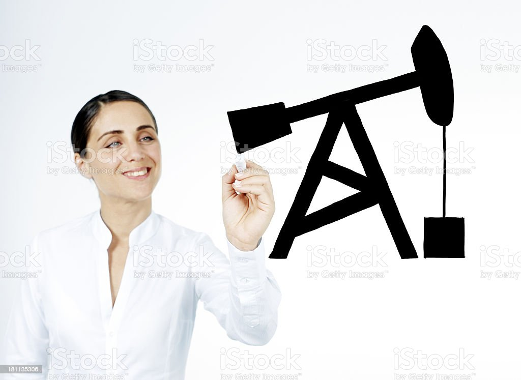 Businessman drawing oil pump royalty-free stock photo