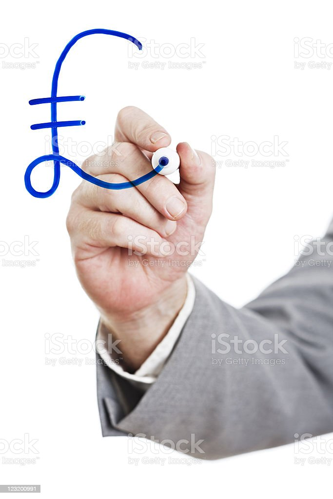 Businessman drawing pound sterling sign on perspex board royalty-free stock photo