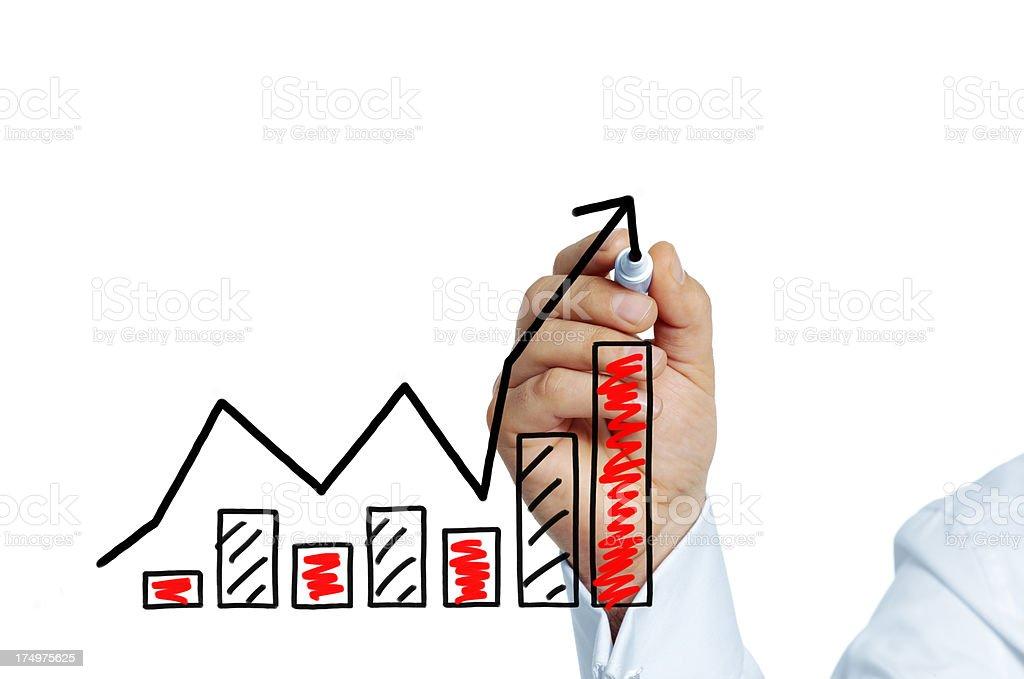 Businessman drawing success graph stock photo