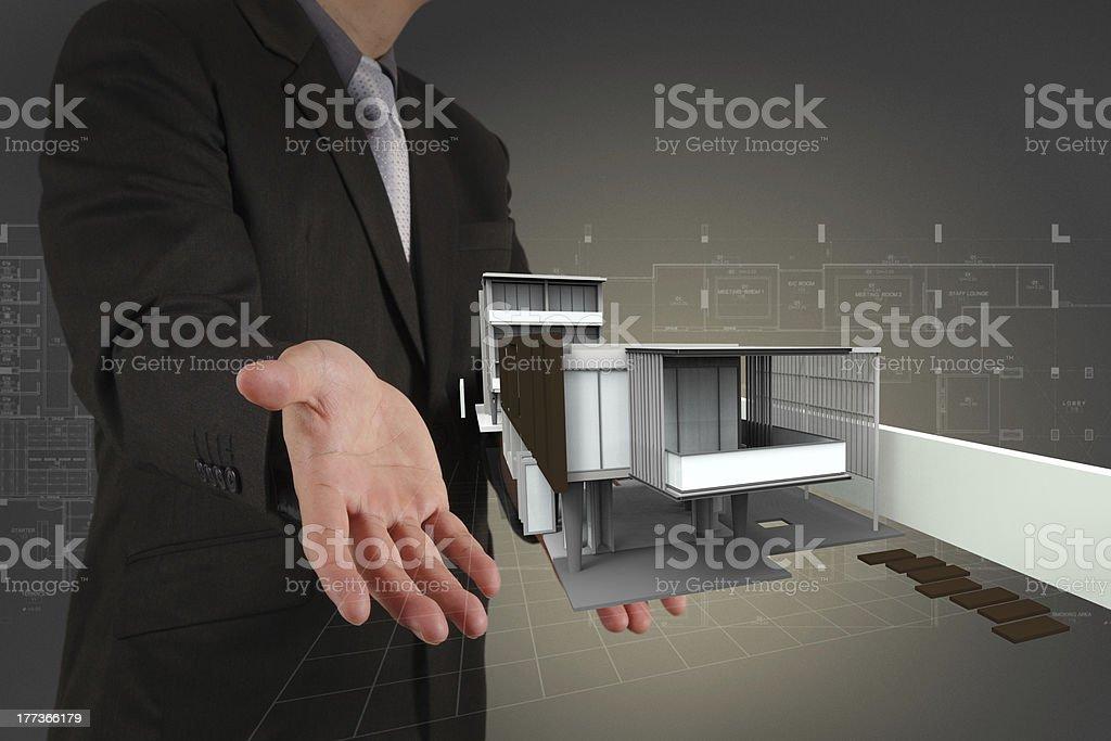 businessman draws building development royalty-free stock photo