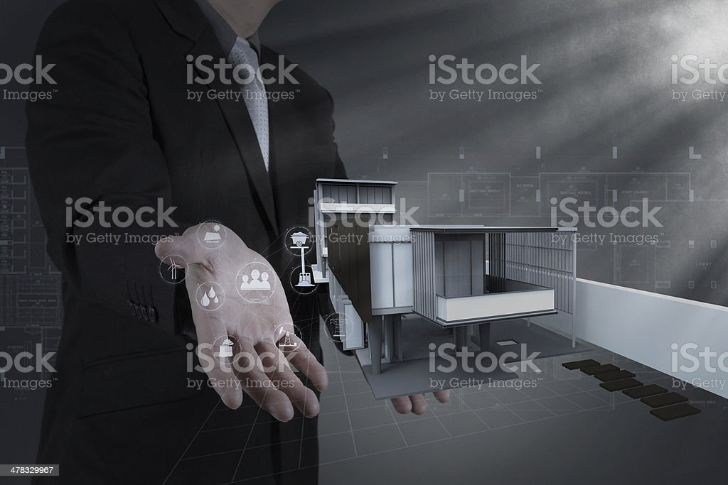 businessman draws building development royalty-free stock photo
