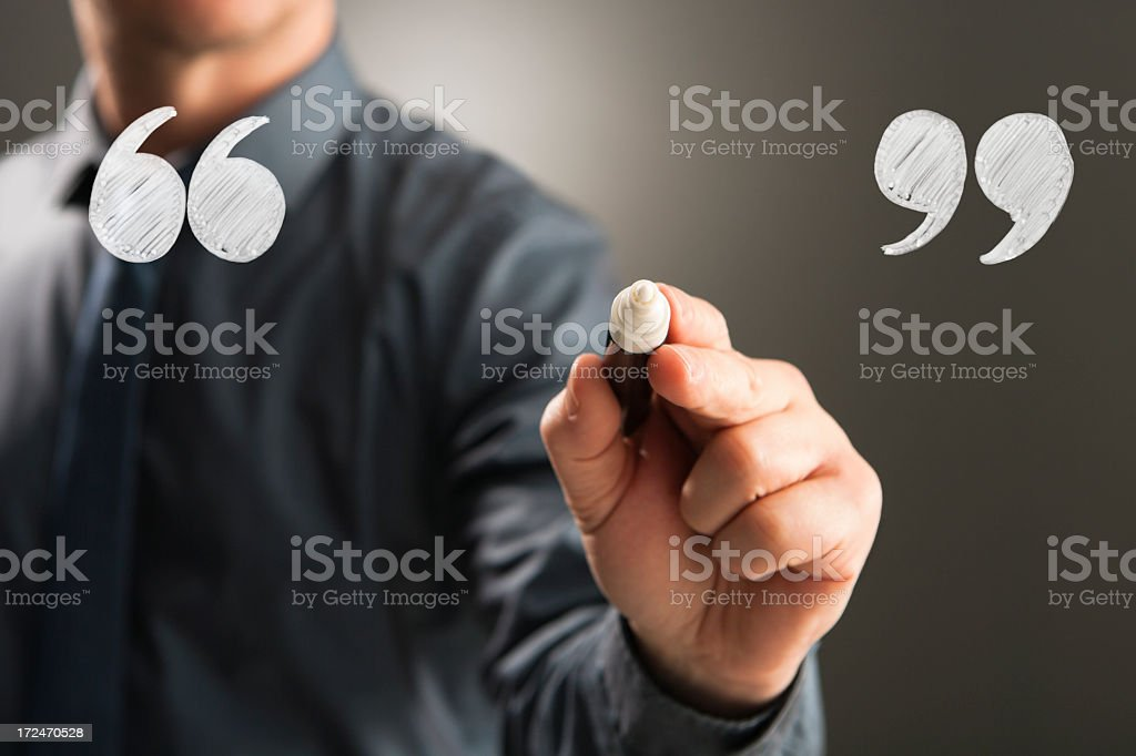 Businessman draws speech marks for your message stock photo
