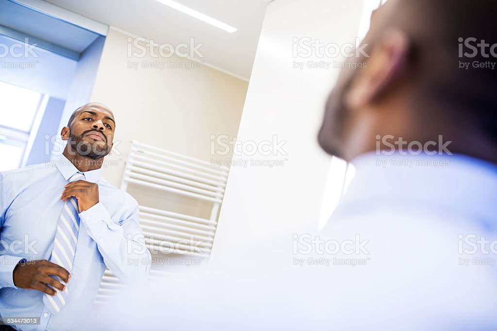 Businessman Dressing for Work stock photo