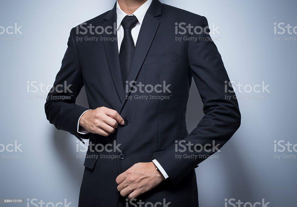 Businessman Dressing Up a Black Suit stock photo