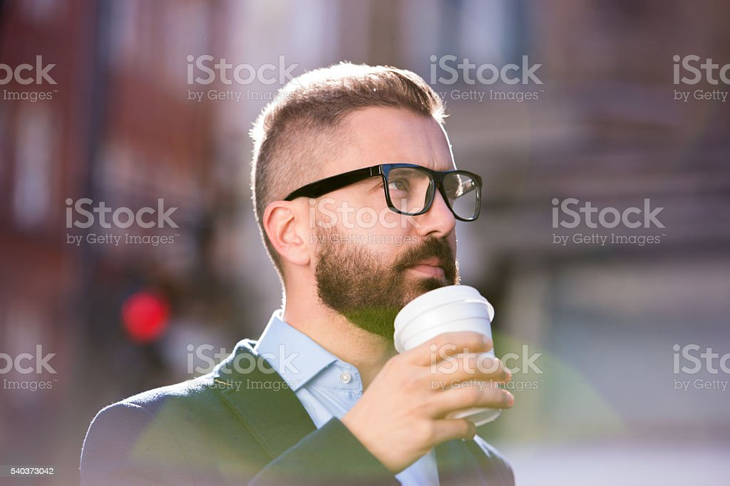 Businessman drinking coffee in the street of London stock photo