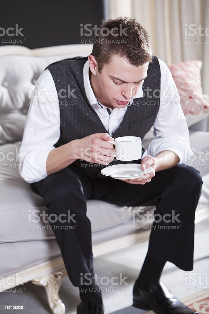 Businessman drinking coffee stock photo