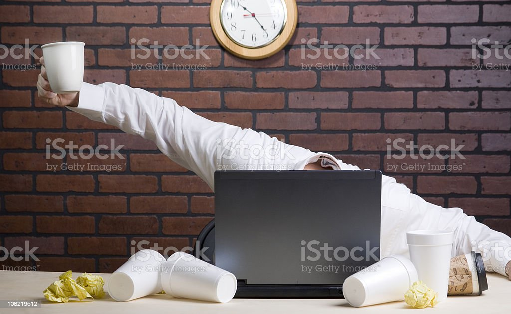 Businessman Drinking Numerous Cups of Coffee royalty-free stock photo