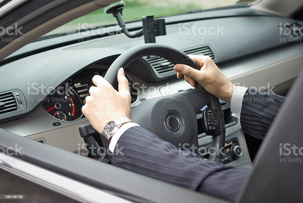 Businessman driving a car royalty-free stock photo