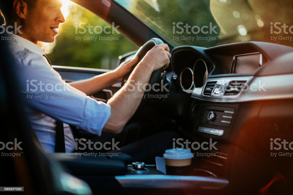 Businessman driving a car stock photo