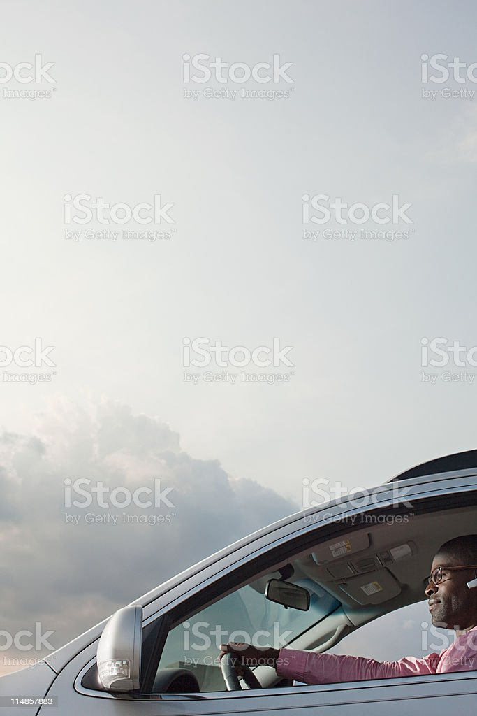 Businessman driving car royalty-free stock photo