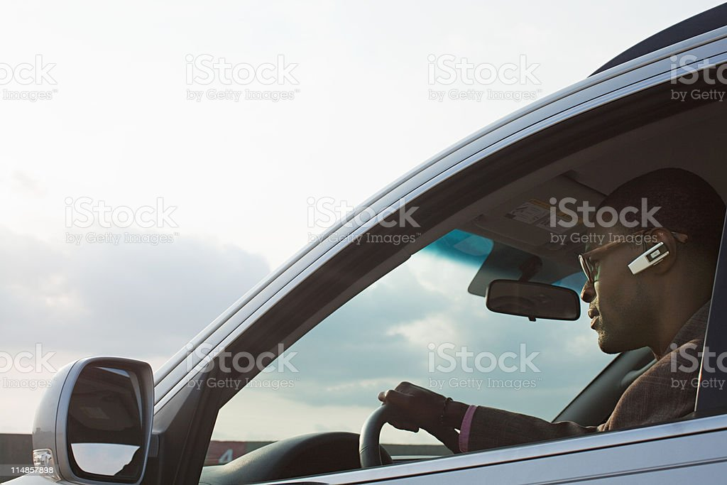 Businessman driving car stock photo