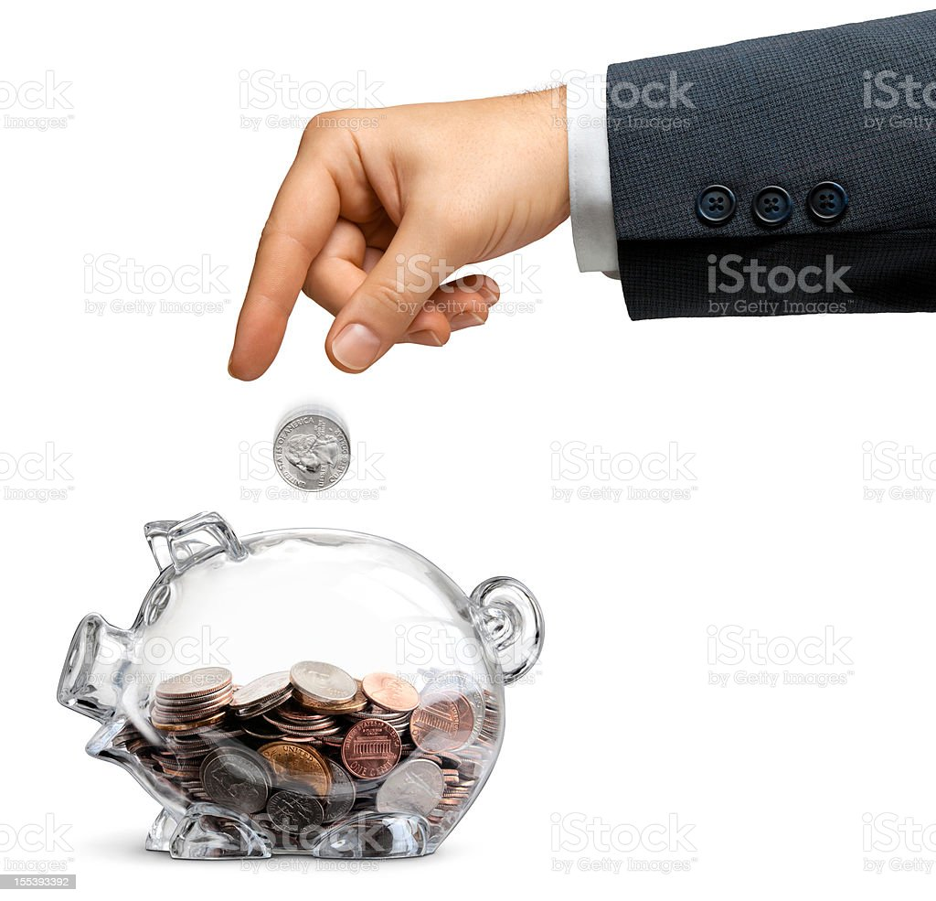 Businessman Drops Money Into A Half-filled Clear Piggy Bank Isolated stock photo