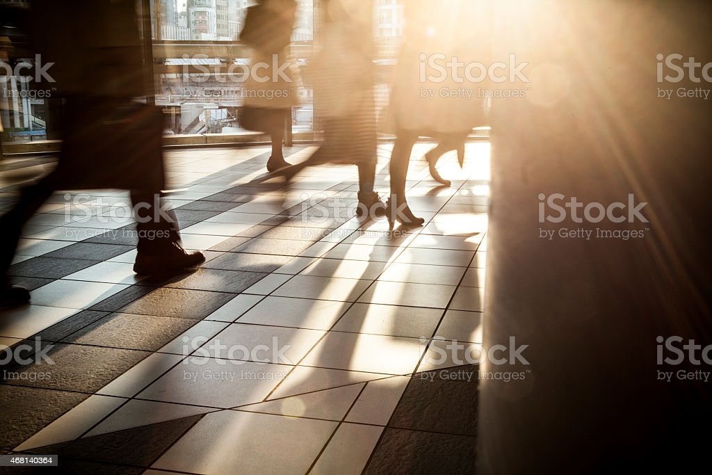Businessman during evening rush hour. stock photo