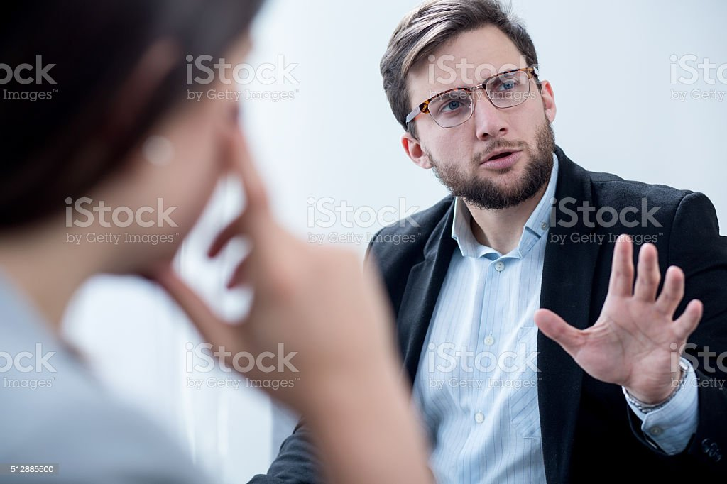 Businessman during psychotherapy session stock photo