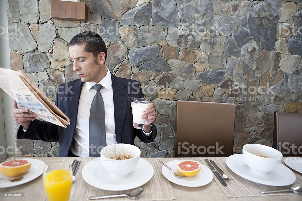 Businessman eating breakfast royalty-free stock photo