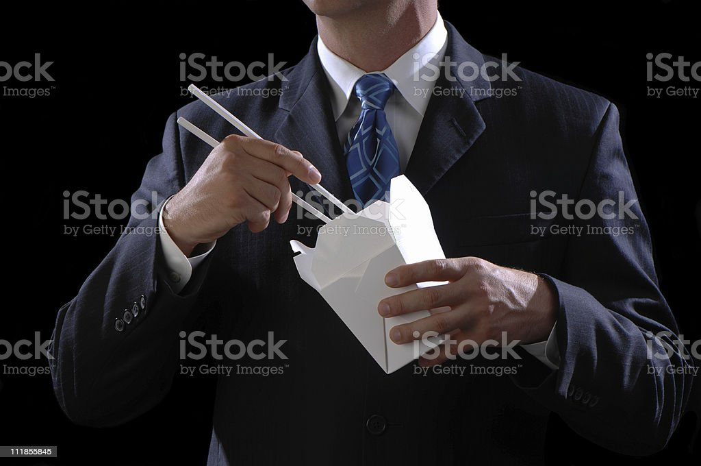Businessman Eating Chinese Food on Black royalty-free stock photo