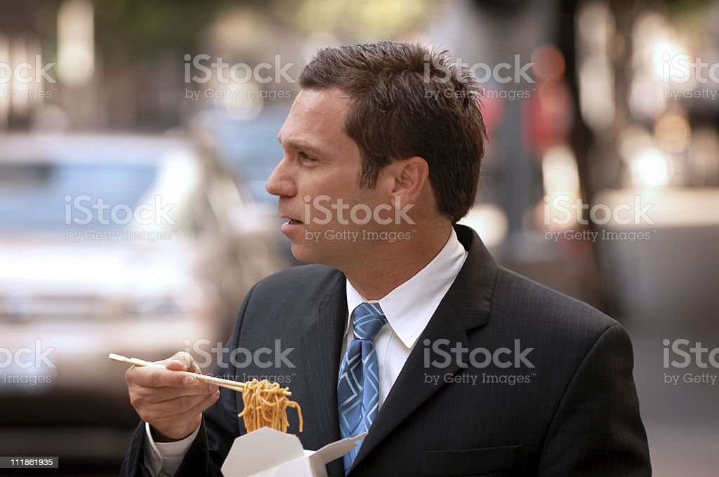 Businessman Eating Chinese Food on the Street royalty-free stock photo