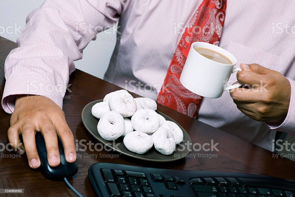 businessman eating donuts and coffee royalty-free stock photo
