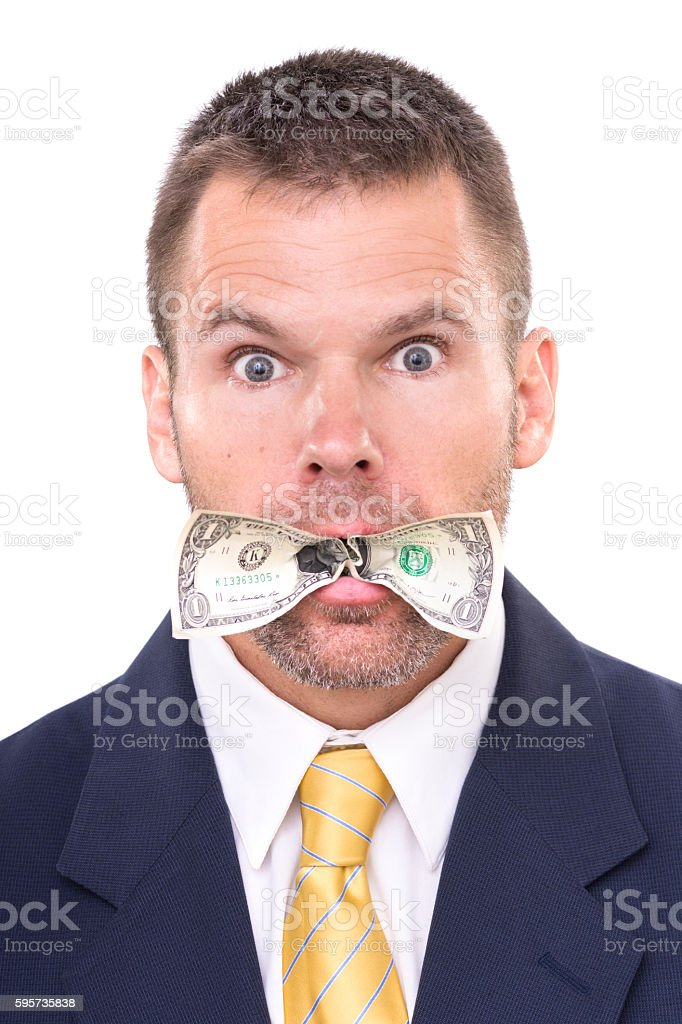 Businessman eating his money stock photo