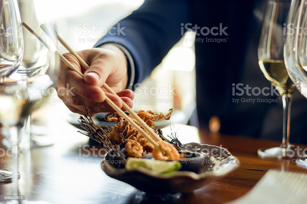 Businessman eating seafood stock photo