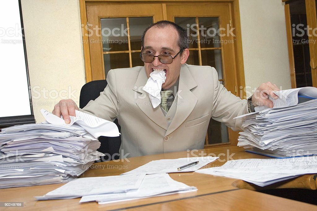 Businessman eating the work royalty-free stock photo