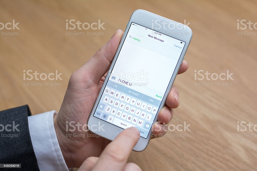 businessman edits message on mobile phone stock photo