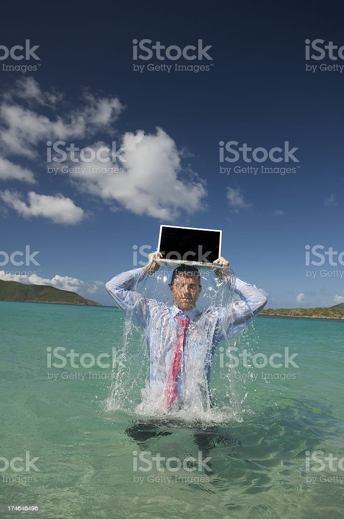 Businessman Emerges from Water with Laptop on Head royalty-free stock photo