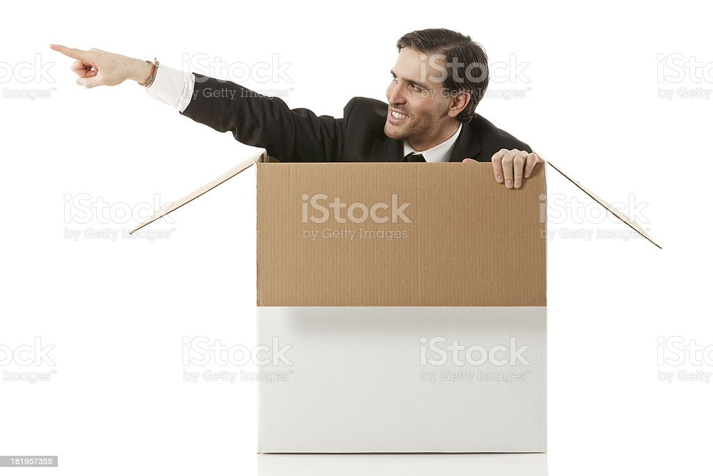 Businessman emerging from box royalty-free stock photo
