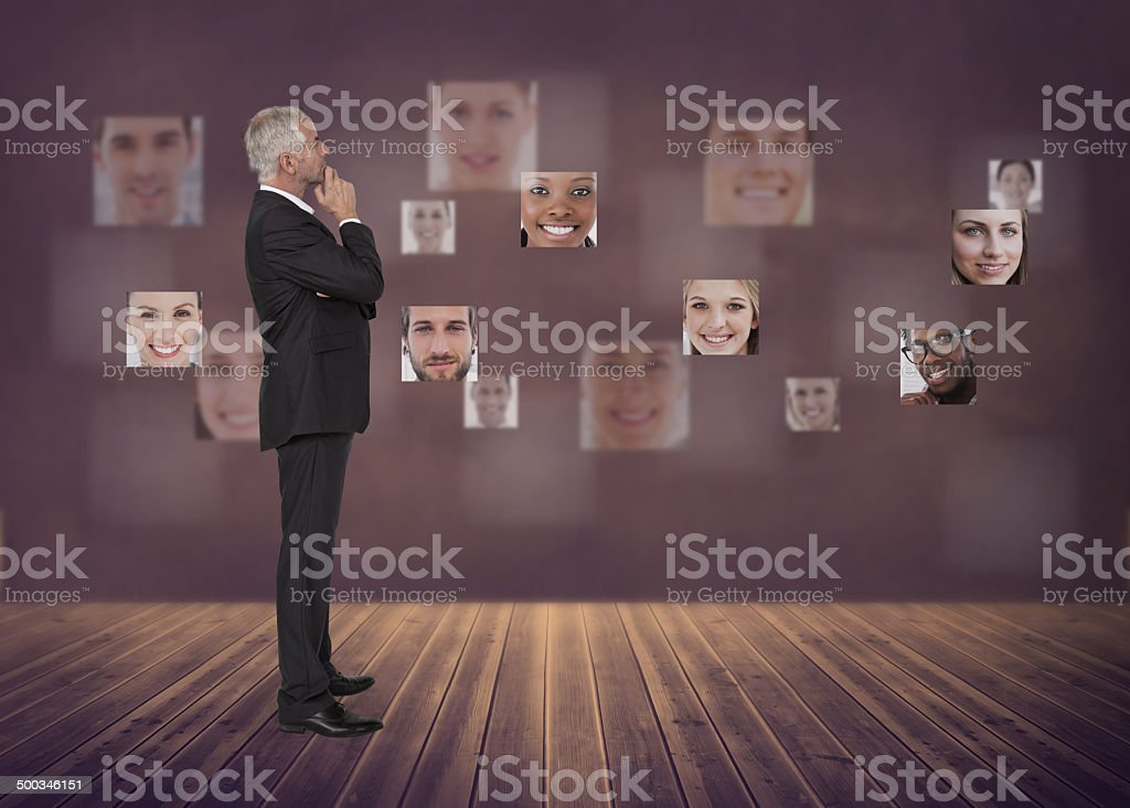 Businessman encircled by digital interface royalty-free stock photo